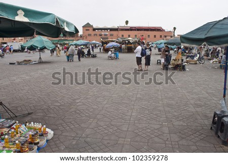 MARRAKESH, MOROCCO - AUGUST 8: Unidentified people visit the Jema el Fna Square in Marrakesh on August 8, 2010 in Marrakesh, Morocco. The square is part of the UNESCO World Heritage.