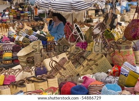 MARRAKESH, MOROCCO - AUGUST 19: Unknown woman selling baskets of all shapes and sizes on August 19, 2009 in the main souk of Marrakesh, Morocco.