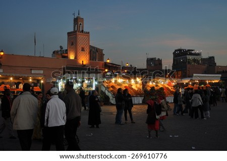 MARRAKESH, MOROCCO - Dec, 27: people walking down the main market square Djemma El Fna at night on December, 27, 2009. MARRAKESH, MOROCCO - stock photo