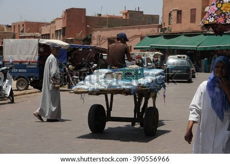 MARRAKESH, MOROCCO - JULY 11: A local man with his cart in  the Jemaa el Fna square of the Old Town of Marrakesh, Morocco on the 11th July, 2016. - stock photo