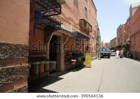 MARRAKESH, MOROCCO - JULY 11: A side street near the Jemaa el Fna square of the Old Town of Marrakesh, Morocco on the 11th July, 2016. - stock photo