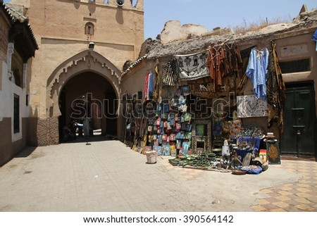 MARRAKESH, MOROCCO - JULY 11: The entrance to an alleyway off the Jemaa el Fna square of the Old Town of Marrakesh, Morocco on the 11th July, 2016. - stock photo