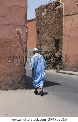 MARRAKESH ,MOROCCO - JUNE 4: Unidentified man walking in the medina of  Marrakesh on June 4, 2013 in Morocco. With a population of over 900,000 inhabitants it is the most important city in Morocco.