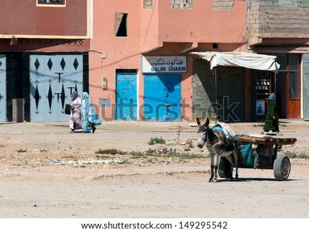 MARRAKESH ,MOROCCO - JUNE 4: Unidentified women walking on a street in Marrakesh on June 4, 2013 in Morocco. In 2009 the medina got part of UNESCO World Heritage. - stock photo