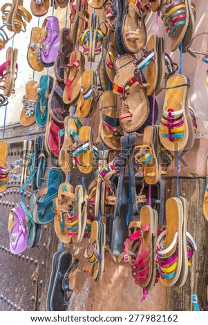 Marrakesh, Morocco: leather shoes to sell on street market in medina - stock photo