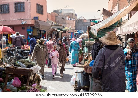 Marrakesh, Morocco - March 3, 2015 : crowded street scene in the old town ( Medina )