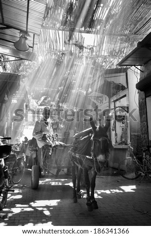 MARRAKESH ,MOROCCO - MARCH 6: Unidentified people at a street in Marrakesh on MARCH 6, 2014 in Morocco. With a population of over 900,000 inhabitants it is the most important city in Morocco. - stock photo