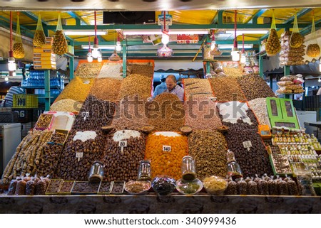 MARRAKESH ,MOROCCO - NOVEMBER 8: Unidentified man selling dry fruits at night at Djemaa el Fna square in Marrakesh on November 8, 2015 in Morocco. Marrakech it is the most important city in Morocco.  - stock photo