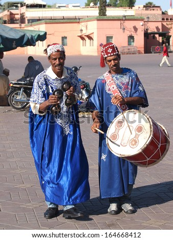 MARRAKESH - OCTOBER 17: Unidentified musicians in Jemaa el Fna Square at sunset, October 17, 2013 in a Marrakesh, Morocco. The square is part of the UNESCO World Heritage                - stock photo