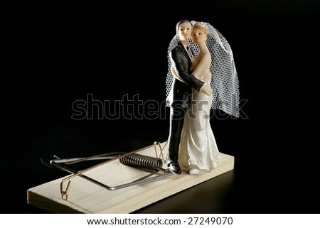 Marriage seen as a mouse trap classic male idea isolated over black - stock photo