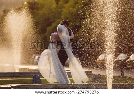 Married couple, enjoying time together at wedding day - stock photo