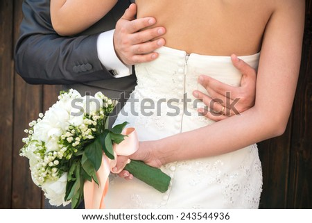 Married couple in day of their wedding, detail of the bust and arms.