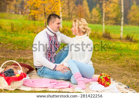 married couple looking into each other's eyes in the park - stock photo