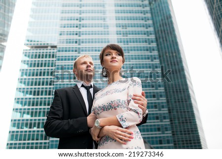 Married couple on a background of city buildings
