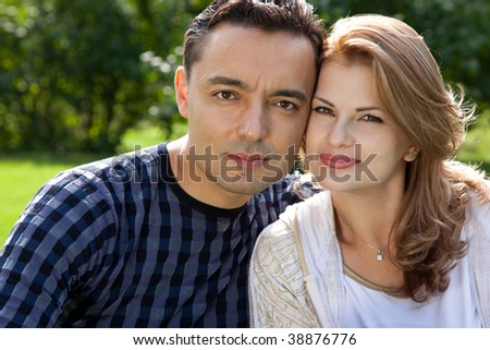 married couple outdoors - stock photo
