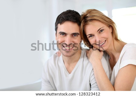 Married couple relaxing at home