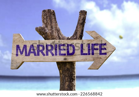 Married Life wooden sign with a beach on background - stock photo