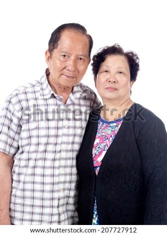 Married senior Asian couple, isolated on white. - stock photo