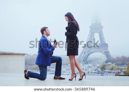 marry me, proposal in Paris near Eiffel Tower - stock photo