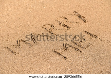 Marry Me Word Written On Sunny Summer Beach Sand