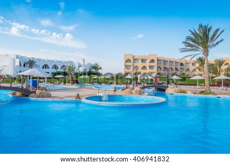 MARSA ALAM , EGYPT, MARCH 29, 2016:   Three Corners Equinox Beach Hotel at Red Sea shore - swimming pools - stock photo