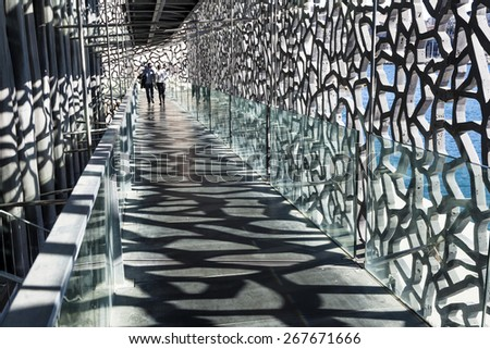 MARSEILLE, FRANCE - APR 5, 2015 : people visit Museum of European and Mediterranean Civilizations. MuCEM was inaugurated on 7 Jun 2013 when Marseille was designated as the European Capital of Culture. - stock photo