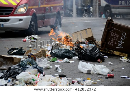 Marseille, France - April 28, 2016 : Garbage on fire during clashes between protesters and french riot police during a demonstration against the labor law - stock photo
