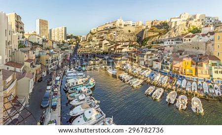 MARSEILLE, FRANCE - JULY 9, 2015 : Fishemen boats in a small harbor. The Vallon des Auffes is a small fishing port of the 7eme district of Marseille, France. - stock photo
