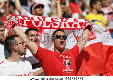 MARSEILLE, FRANCE - JUNE 21, 2016: Polish fans show their support during the UEFA EURO 2016 game Ukraine v Poland at Stade Velodrome in Marseille. Poland won 1-0 - stock photo
