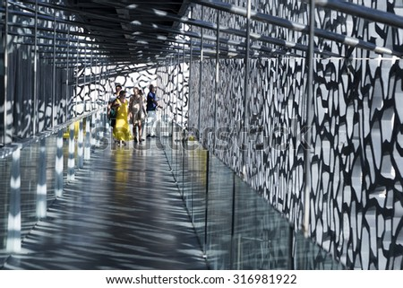 MARSEILLE, FRANCE - MAY 11, 2015 : people visit the modern  Museum of European and Mediterranean Civilizations (MuCEM). It was was inaugurated on 2013 when the city was the European Capital of Culture - stock photo
