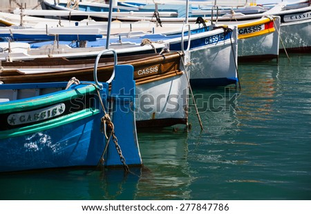 Marseille,France - May 8,2011: Typical colorful fishing boats in the harbor at Marseille.