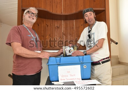 Marseille, France - October 06, 2016 : French cartoonists Pierre Ballouhay and Faty Bourayou at the 5th edition of the International festival of press and political cartoons at l'Estaque.