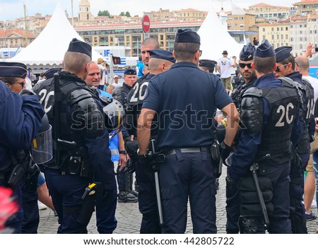 MARSEILLE - JUNE 18 : French riot police controlls the city before a football match on 18 June 2016 in Marseille, France. EURO 2016 takes place in France in 2016.