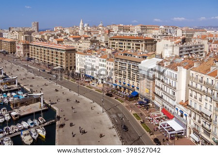 MARSEILLES, FRANCE - MAR 15, 2016 : Aerial view on the quay of the old port, the town and the city hall of Marseille, France on march 15, 2016. - stock photo