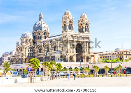 MARSEILLES, FRANCE - MAY 11, 2015 : Tourists walking in front of the Cathedrale de la Major in Marseilles. Built between 1852 and 1893, it is considered as one of the biggest cathedrals of its time. - stock photo