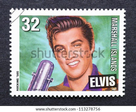 MARSHALL ISLANDS -Â?Â? CIRCA 1997: A postage stamp printed in Marshall Islands showing an image of Elvis Presley, circa 1997. - stock photo