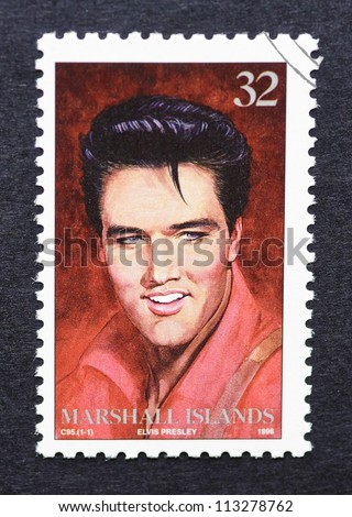 MARSHALL ISLANDS -Â?Â? CIRCA 1996: A postage stamp printed in Marshall Islands showing an image of Elvis Presley, circa 1996. - stock photo