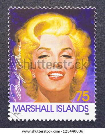 MARSHALL ISLANDS -Â?Â? CIRCA 1995: a postage stamp printed in Marshall Islands showing an image of Marilyn Monroe, circa 1995. - stock photo
