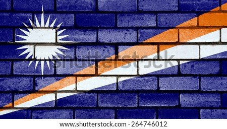 Marshall Islands flag painted on old brick wall texture background  - stock photo