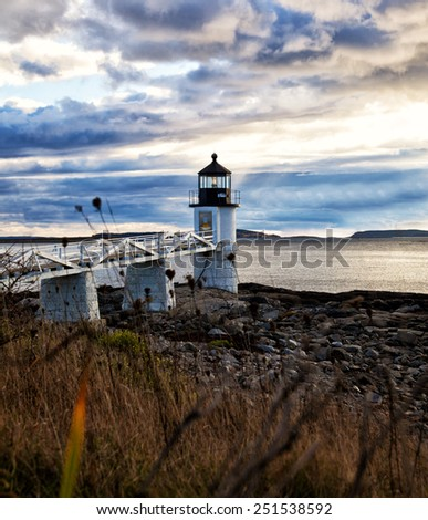 Marshall Point Lighthouse at sunset - stock photo
