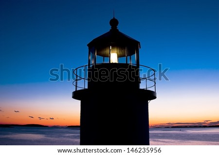 Marshall Point Lighthouse at sunset on the coast of Maine. - stock photo