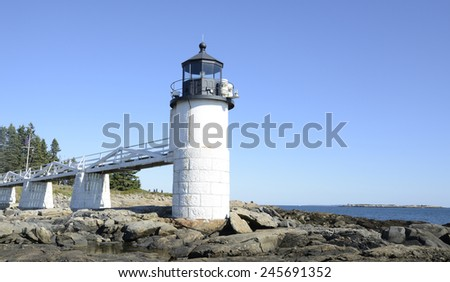 Marshall Point Lighthouse by the rugged coast of Maine - stock photo