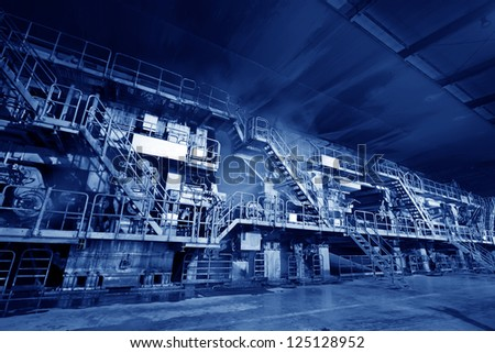 Marshalling of machinery equipment in a papermaking factory, steam and noise has serious harm - stock photo