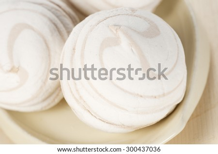 Marshmallow fluff on a plate, close up shot