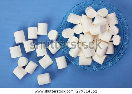 marshmallow on blue background