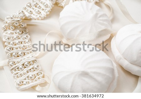 Marshmallow with white headband. Sweet homemade dessert and pearl. Wedding background