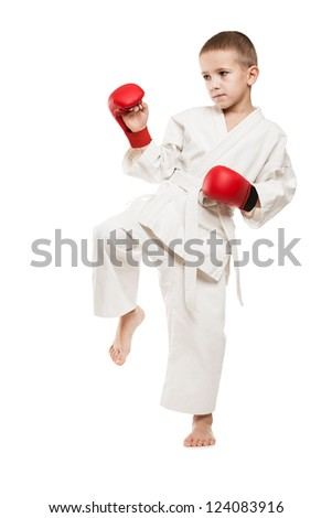 Martial art sport - child boy in white kimono training karate punch or kick