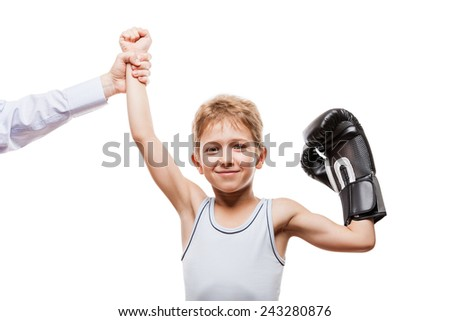 Martial art sport success and win concept - smiling boxing champion child boy gesturing for first place victory triumph - stock photo