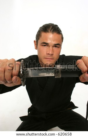 martial artist opens katana a single edged  Japanese sword