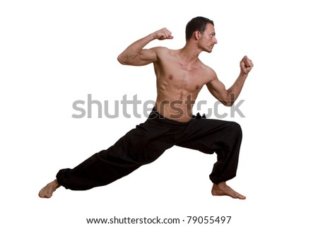 Martial Arts fighter praciticing a defence move, isolated on white. - stock photo